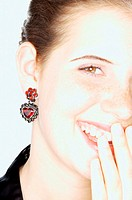 Laughing woman with heart shaped earring (thumbnail)