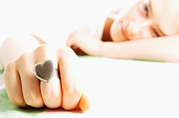 Young woman wearing heart shaped ring