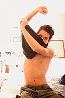 Man undressing (thumbnail)