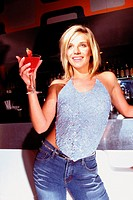 Woman with cocktail in nightclub