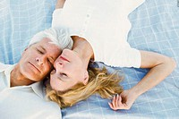 Couple lying down together