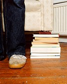 A pile of books holding a sofa (thumbnail)