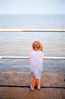 Small girl looking at the sea (thumbnail)