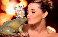 Woman kissing toy frog