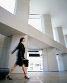 Businesswoman Walking in a Lobby