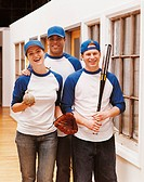 Team Portrait of Businessmen and a Businesswoman Wearing Baseball Sportswear