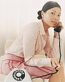 Portrait of a Stylish Businesswoman Using a Telephone