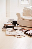 Folders, Newspapers and Documents on a Wooden Living Room Floor