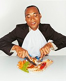 Greedy Businessman Eating a Big Meal