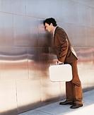 Businessman Banging His Head Against a Wall