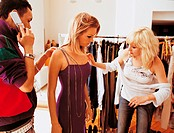 Stylists Dressing a Young, Female Fashion Model