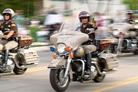 Motorcycle cops in a parade on Harley Davidson motorcycles