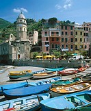 Boats and cathedral. Vernazza. Cinque Terre. Liguria. Italy