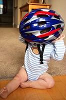 baby with bike helmet