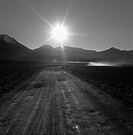 Black and white image road at sunset (thumbnail)