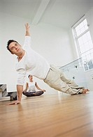Couple exercising together at home (thumbnail)