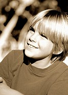 Brown duotone closeup smiling boy (thumbnail)
