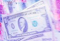 Blurred distorted image of American dollar notes on background of other currencies (thumbnail)