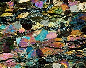Peridotite. Polarised  light  micrograph  of    a section  through  peridotite.   This is a plutonic rock, one that forms only very deep in the Earth´...