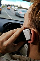 Mobile phone use.   Man  using  a mobile phone while driving. Legislation introduced on 1 December 2003 made it illegal to use a  hand- held   mobile...