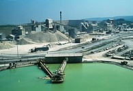 Lime works.  Industrial plant for the treatment of the  quarried  mineral  limestone.   Limestone is calcium carbonate (CaCO3),  which is an  importan...
