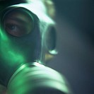 Gas mask.  Close-up of the face of a man wearing a respirator.   This  could  represent an individual involved in terrorism or the precaution  taken  ...