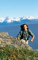 Hiker along Turnagain Arm in summer. Chugach State Park. Alaska