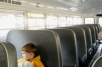 3 years old boy on school bus. Hamilton, Ontario. Canada