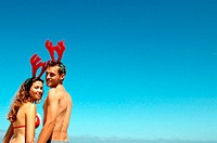 Couple with reindeer head decoration
