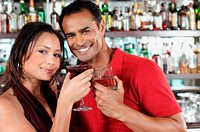 Smiling couple in bar