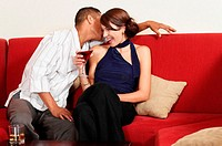 Couple flirting on sofa