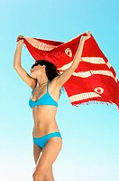 Woman in bikini holding towel