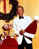 C Crosby, Bing  2.5.1904 - 14.10.1977, US Schauspieler, PR Foto zum Film: ´Weiße Weihnachten´, 1954  nikolausmütze mütze nikolaus in hand haltend, wei...