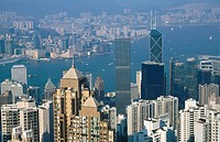 Aerial view of Hong Kong Island. Victoria Harbor and Kowloon from Victoria Peak. China