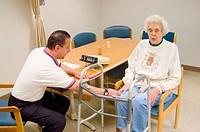 Senior woman rehabilitating after suffering stroke