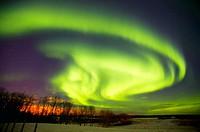 Northern lights over farmland in winter. Alberta, Canada