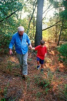 Grandfather and grandson in woods