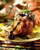 Roast pork with olive and anchovy stuffing and sage