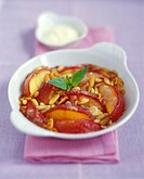 Sweet nectarine gratin with pine nuts
