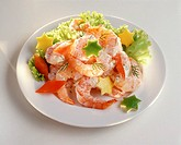 Shrimp salad with carved citrus fruits