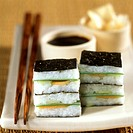 Maki sushi squares with soy sauce as party snacks