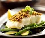 Fish with herb crust on green beans