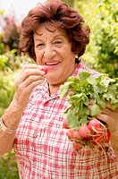 Older woman with radishes