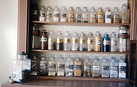 Western gold mining town: drugstore, old apothecary jars. Columbia State historic park. California. USA
