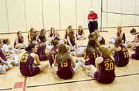 Middle school females participate in volleyball game