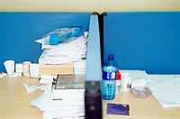 Untidy adjoining office desks