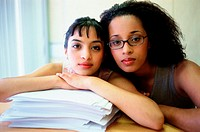 Two women and stack of paper