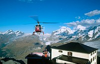Alpine succour with helicopter. Matterhorn. Swiss Alps