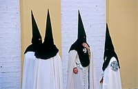 Penitents in Holy Week procession. Seville. Spain