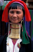 Long neck Padaung woman at the window, Myanmar